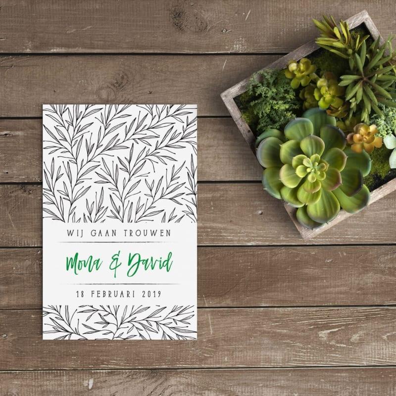 Ontwerpstijl van Trouwkaart Trendy Takjes is modern en minimalistisch; op de achtergrond een patroon van trendy takjes; ontwerp in zwart-groen kleurenpalet.