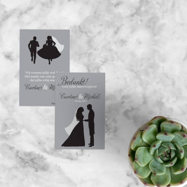 Bedankje Silhouet gebruikt dezelfde illustraties als de gelijknamige trouwkaart: abstracte silhouetten in grijs en zwart.